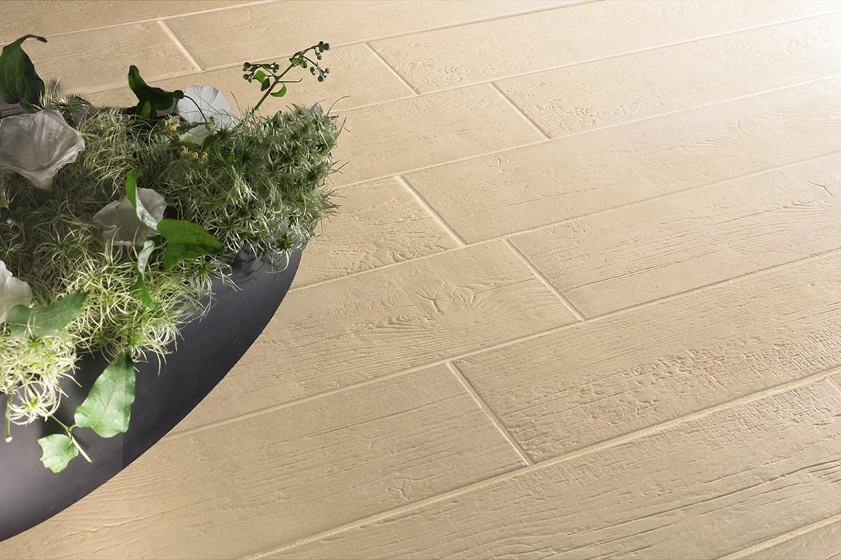 Faux wood floor tiles wood crema 12 5x50 cm for Fake hardwood tile